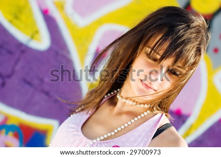 Teenage with different accessories, with a graffiti background, fashion look - stock photo