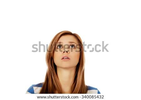 Teenage woman eyes looking up. - stock photo