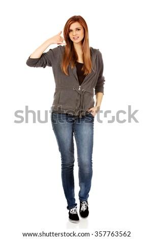 Teenage woman gesturing call me sign. - stock photo