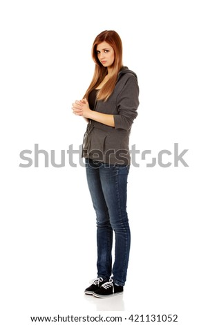 Teenage woman praying-religion concept - stock photo