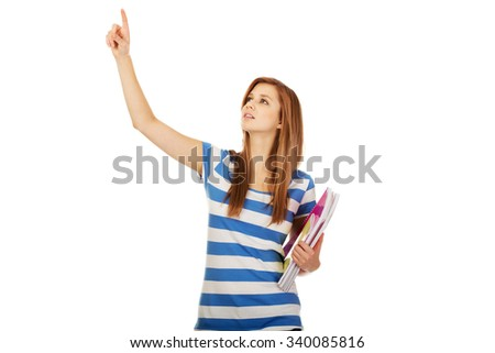 Teenage woman showing copyspace or something. - stock photo