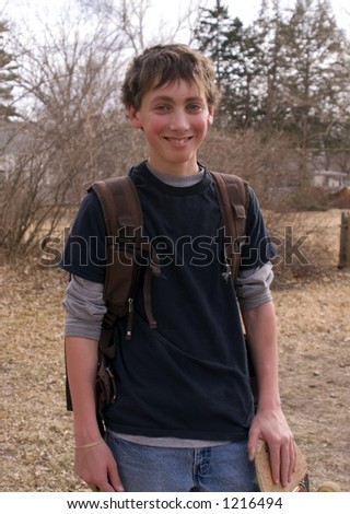 Teenaged boy with a backpack