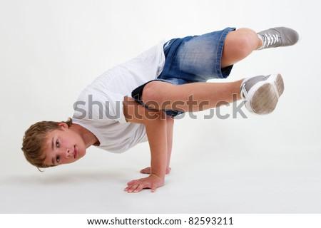 Teenager bboy training on white background - stock photo
