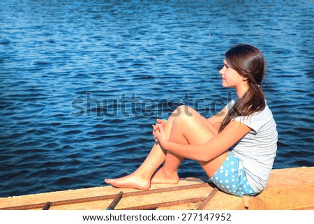 teenager beautiful girl on the country summer lake background - stock photo