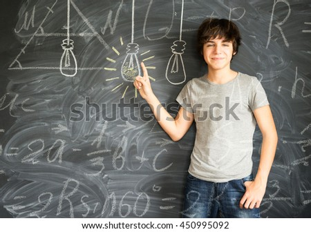 Teenager boy getting an idea with math formulas - back to school education and study concept