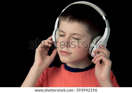 teenager boy in headphones listening to music - stock photo