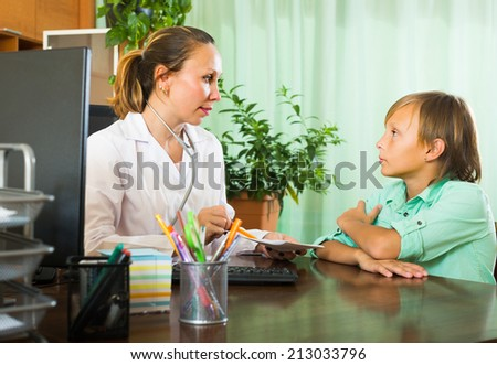 Teenager boy patient complaining to doctor about symptoms of malaise - stock photo