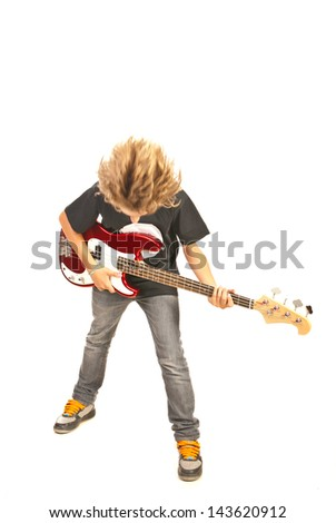 Teenager boy playing bass guitar and flipping hair isolated on white background - stock photo