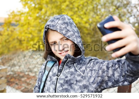 teenager boy taking selfie with mobile