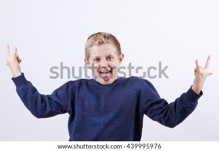 teenager boy teenager laid rock fingers and stuck out his tongue. - stock photo