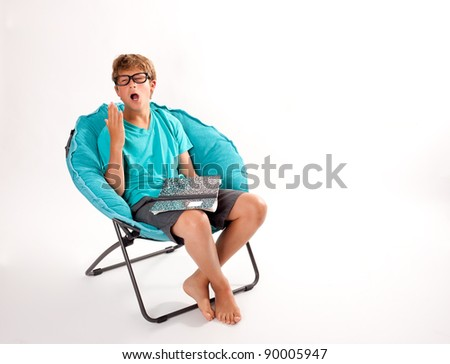Teenager Boy tired of Studying shot in a studio - stock photo
