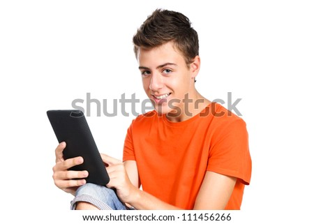 teenager boy touching a tablet's screen isolated over white - stock photo