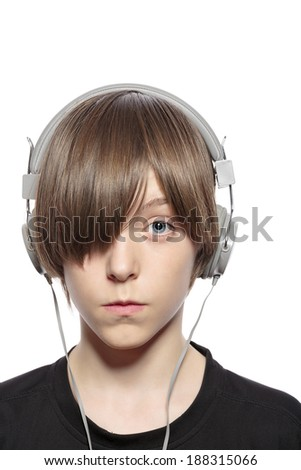teenager boy with hair over one eye and headphones, isolated on white. - stock photo