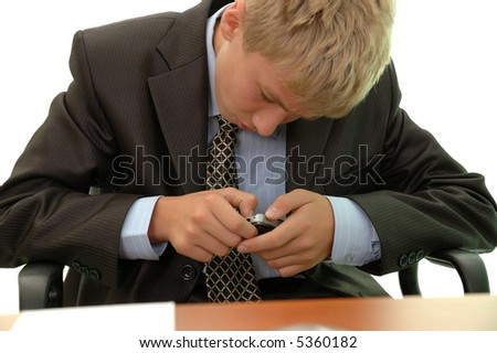 teenager - businessman is keen on mobile phone.