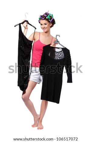 teenager chooses dress for the party - stock photo