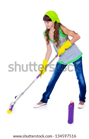 Teenager cleaning floor with a mop - stock photo