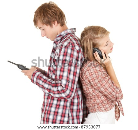 teenager couple with mobile phones, white background - stock photo