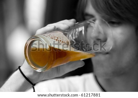 Teenager drinking beer. Black and white - stock photo