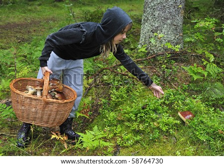 Teenager found a big mushroom - stock photo