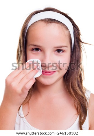 Teenager girl cleaning her face with cotton pad - stock photo