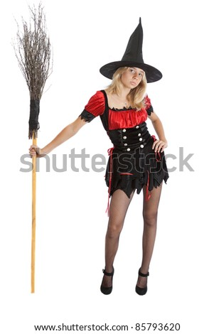 teenager girl in Halloween witch with broom - stock photo