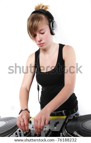Teenager girl mixing two vinyl records - stock photo