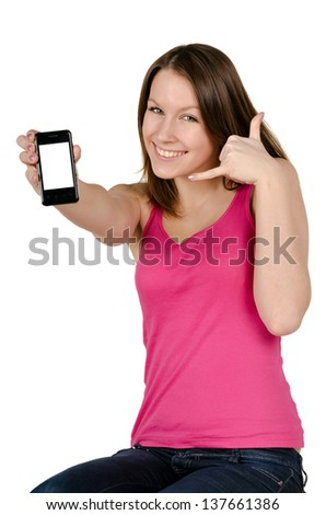 Teenager Girl (16) On Cell Phone Isolated on a White Background - stock photo