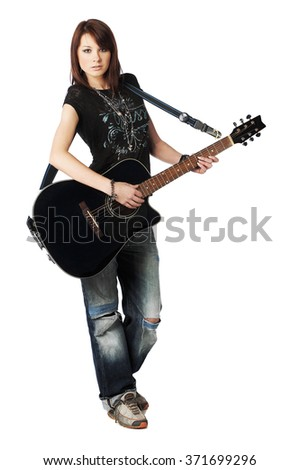 Teenager girl playing an acoustic guitar - stock photo