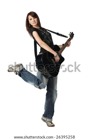 Teenager girl playing an acoustic guitar, isolated on white - stock photo