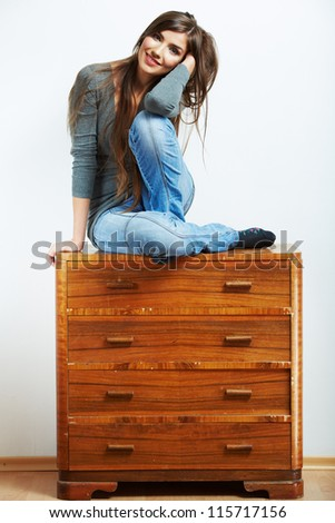 Teenager girl portrait. Young smiling woman seat at stock. Beautiful female model portrait - stock photo