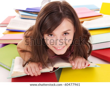 Teenager girl reading pile colored book.