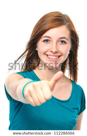 teenager girl shows a thumbs up on white background - stock photo