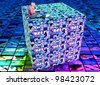 teenager girl with a laptop sitting on a cube with technology images - stock photo