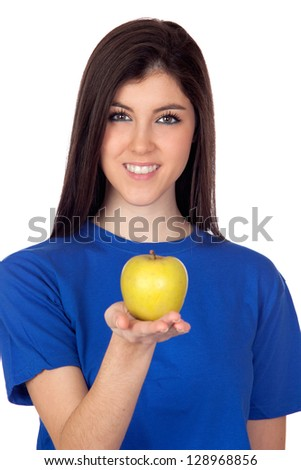 Teenager girl with a yellow apple isolated on white background - stock photo
