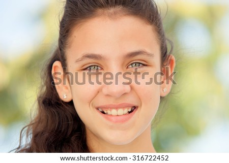 Teenager girl with blue eyes smiling outdoor