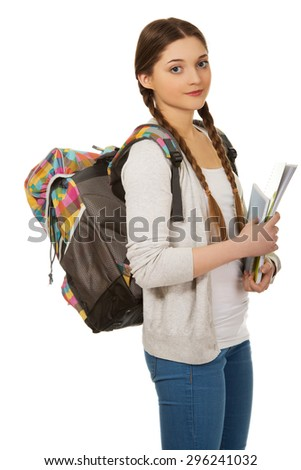 Teenager girl with school backpack holding folders. - stock photo