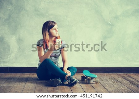 Teenager girl with skateboard portrait