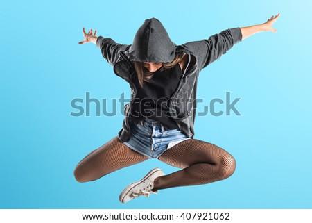 Teenager hip-hop dancer jumping - stock photo