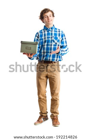 teenager holding a box - stock photo