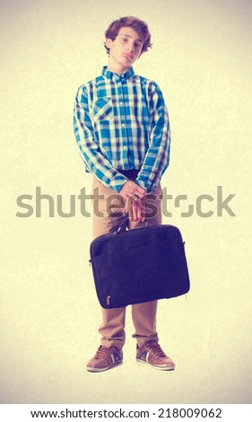 teenager holding a suitecase - stock photo