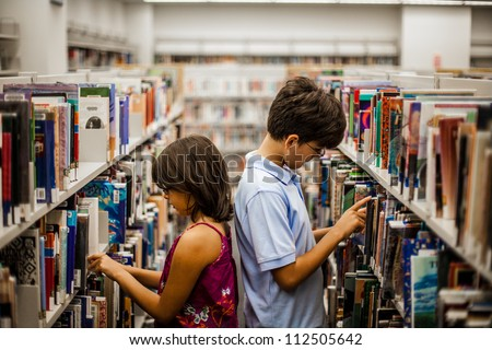 Teenager in a library are reading books - stock photo