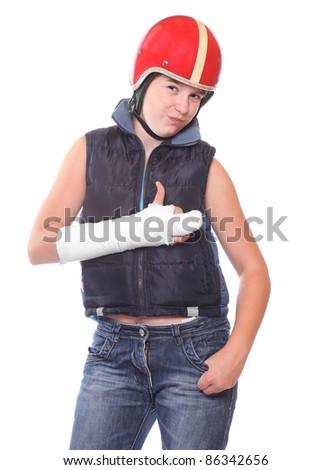Teenager in protective helmet with broken arm. Insurance metaphor. - stock photo