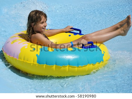 Teenager in water attraction - stock photo