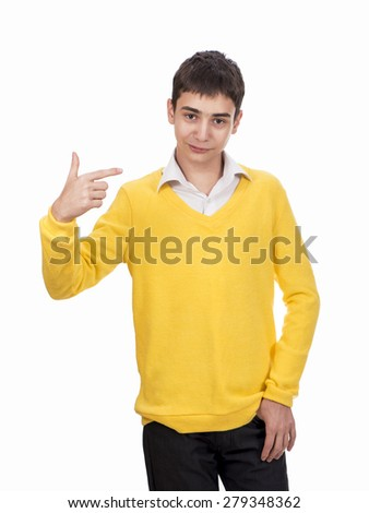 Teenager in yellow sweater indicates the need to make a choice on a white background - stock photo