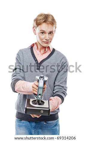 Teenager is holding a joystick and playing computer game over white background - stock photo