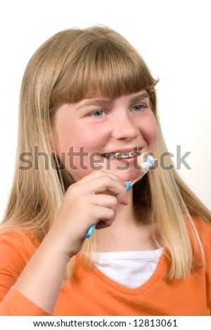 Teenager is ready to clean her teeth with braces on them. - stock photo