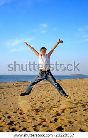 teenager jumping on the empty beach