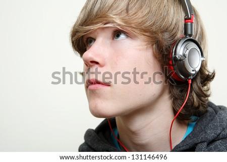 Teenager listening to music - stock photo