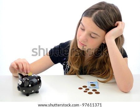 Teenager making euro money savings - stock photo