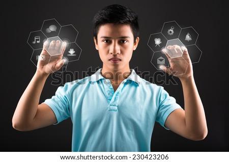 Teenager pushing digital buttons, futuristic technology - stock photo